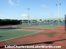 the tennis courts overlook the beautiful lake